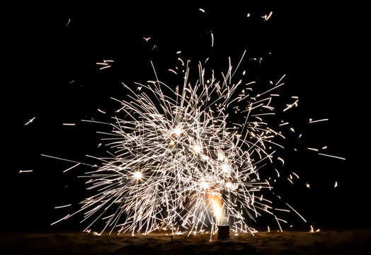 Fireworks Explode on a Beach at Night Close Up