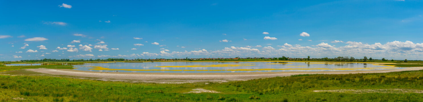 a saline lake situated next to the neusiedlersee and Ilmitz village in Burgenland, Austria.