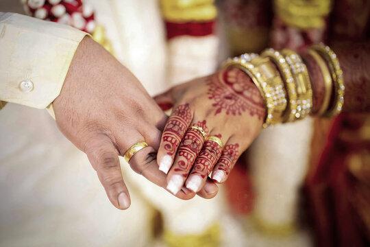 Asian Hindu Wedding Couples Hand together
