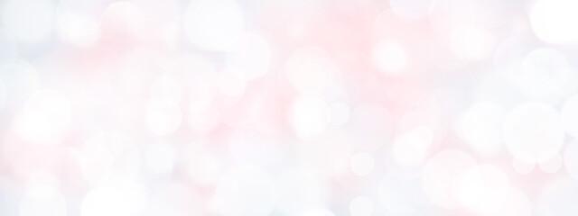 黄色やグレーも入ったやさしいピンクの背景