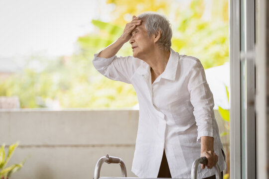 Exhausted senior woman has headache dizziness from the sizzling summer temperatures,old elderly suffering from hot summer weather,symptoms of heat stroke,high temperature on a sunny day,feeling faint