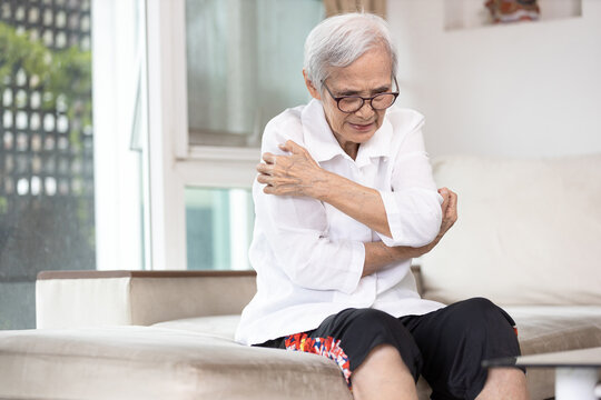 Itchy senior woman scratching arms with her hands,rash on body,pruritus,severe itching of the skin from food allergies,symptoms of hives,urticaria disease,patient allergic reaction,atopic dermatitis.