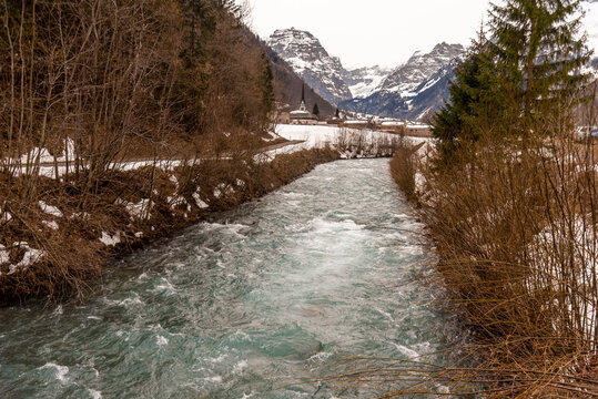 river in the swiss mountains near the town of Linthal in Glarus süd