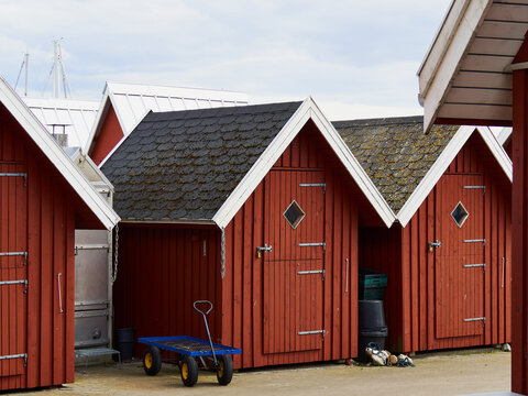 Beautiful red fishing huts on the coast