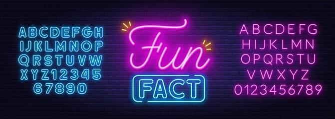 Fototapeta Fun Fact neon sign on brick wall background.
