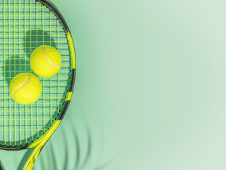Fototapeta Tennis. Spring sport composition with yellow tennis ball and racket on a green background of tennis court with copy space. Sport and healthy lifestyle. The concept of outdoor game sports. Flat lay obraz