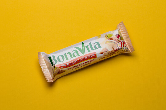 Moscow, Russia - April 21 2021: Bona Vita wholegrain cereal bar on blue background.