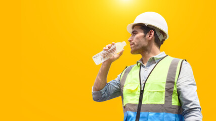 Fototapeta The construction worker drinks water to quench his thirst.