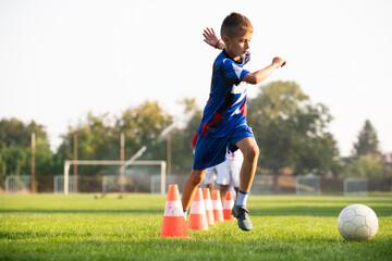Boy Soccer Player In Training.
