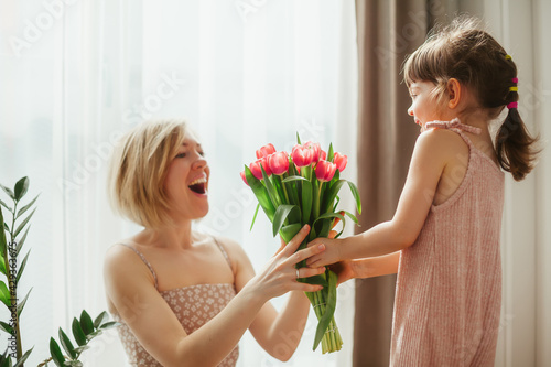 Little girl congratulating her mother wih Mother's Day