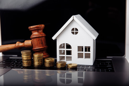 Wooden gavel and house. Online auction