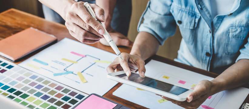 Team of Creative Web/Graphic Designer planning, drawing website ux app for mobile phone application and development template layout, process to developing prototype wireframe, User experience concept