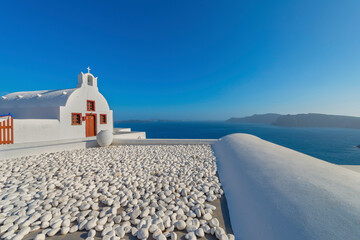 Fototapeta View to the sea and Volcano from Fira the capital of Santorini island in Greece