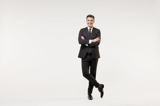 Full length young successful employee business corporate lawyer man 20s wearing classic formal black grey suit shirt tie work in office hold hands crossed folded isolated on white background studio.