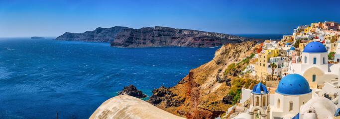 Fototapeta Scenic pnorama of Blue domes in Oia village. Santorini island. Greece