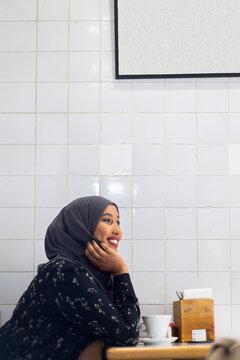 Black Muslim Woman in cafe