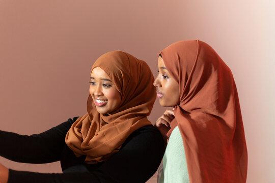 Black Muslim Women taking a selfie