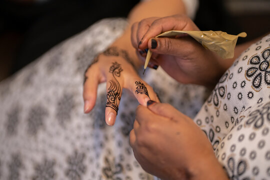 Traditional henna being applied on a girl