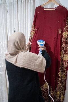 Girl steaming traditional wedding dress