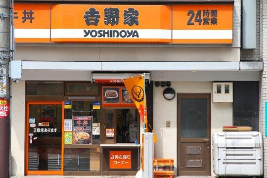 OSAKA, JAPAN - APRIL 25, 2012: Yoshinoya restaurant in Osaka. Yoshinoya is the largest chain of gyudon restaurants (beef bowl). It was established in 1899.