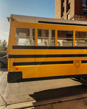 Yellow school bus parked on sunny day