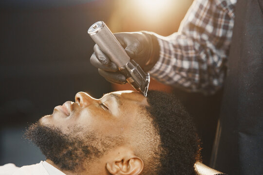 Young African-american man visiting barbershop