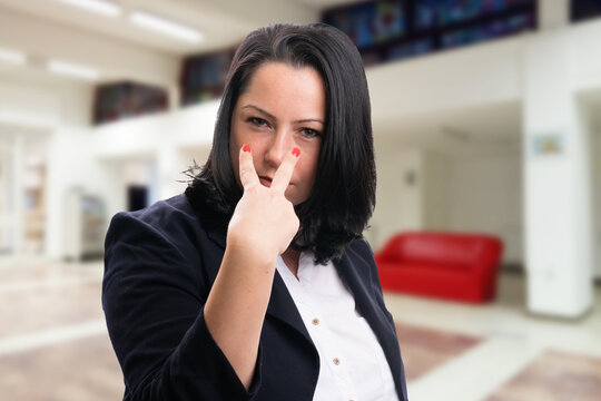 Corporate businesswoman making eye contact gesture supervisor