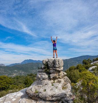 lady at top of hill after hiking