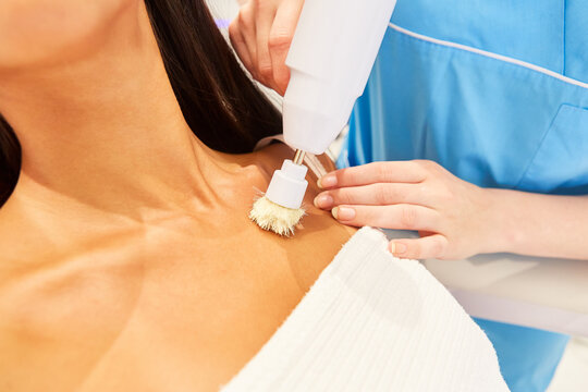 Woman having skin cleansing and lymph massage