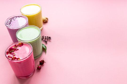 Colorful latte coffee or tea - with blue spirulina turmeric and matcha