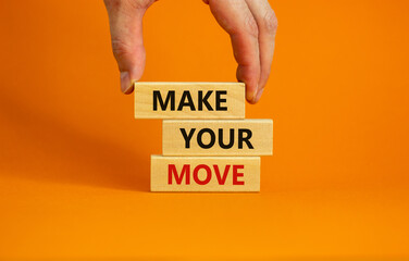 Make your move symbol. Wooden blocks with words 'Make your move'. Beautiful orange background, businessman hand. Business, make your move concept, copy space.