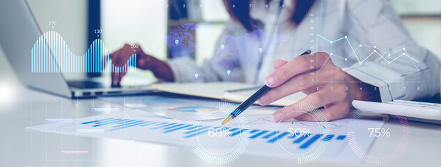 Obraz Financial Businesswomen analyze the graph of the company's performance to create profits and growth, Market research reports and income statistics, Financial and Accounting concept. - fototapety do salonu