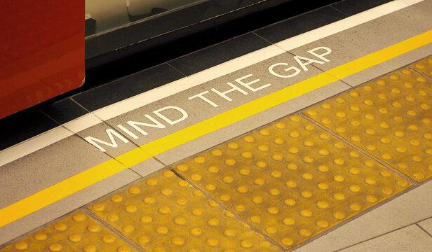 Mind the gap sign on the subway train platform.
