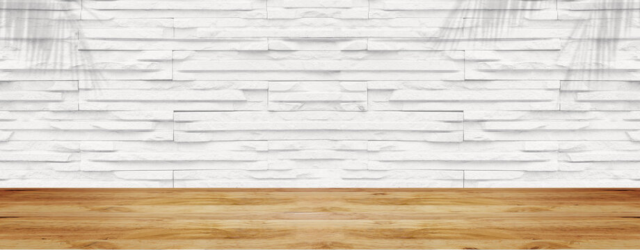 Empty wood table with white stone wall texture background. For display or montage your products.
