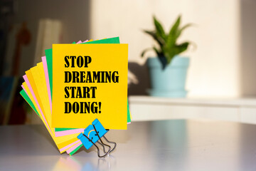Text sign showing Stop Dreaming Start Doing