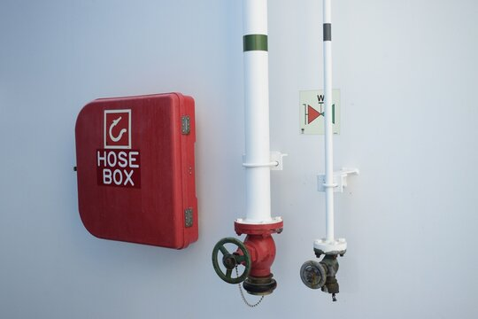fire extinguisher hose box on the wall