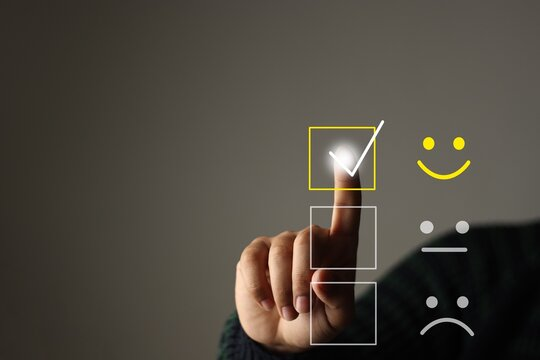 Customer service and Satisfaction concept ,Business people are touching the virtual screen on the happy Smiley face icon to give satisfaction in service. rating very