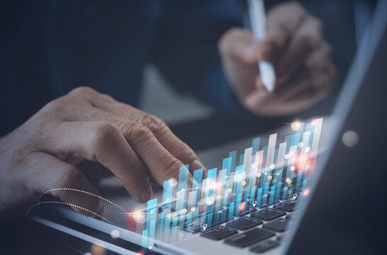 Businessman analysing market report, trading graph financial data. Business finance background