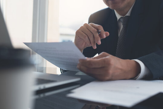 Signing contract, business agreement and deal concept. Businessman reading before signing business contract documents