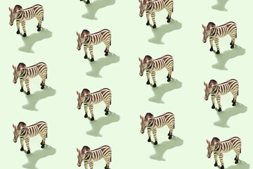 Fototapeta Cheerful patern with plastic toy zebra on green background in sunlight - Concept about the world of animals and wild life