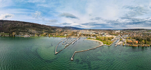 Obraz Panoramic aerial view over Lake Biel with a view of the city of Biel Bienne and the city's bank and port. Canton Bern, Switzerland - fototapety do salonu