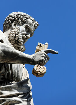 saint peter with the long beard and the keys of heaven on background of blue sky