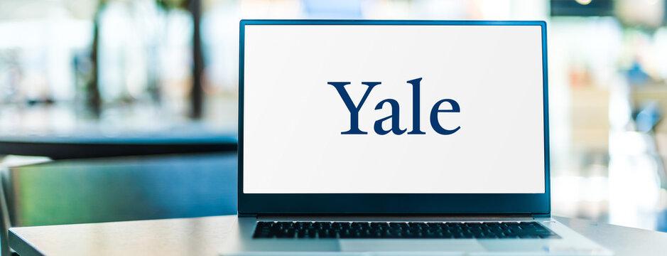 Laptop computer displaying logo of Yale University