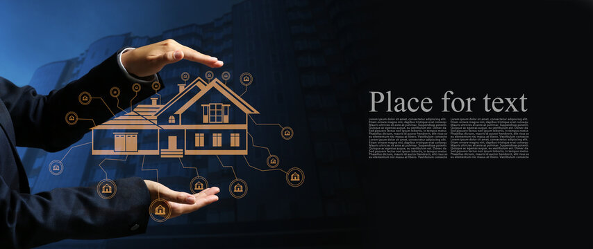 Real estate agent with digital projection of building on dark background with space for text