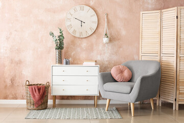 Fototapeta Interior of stylish living room with modern chest of drawers obraz
