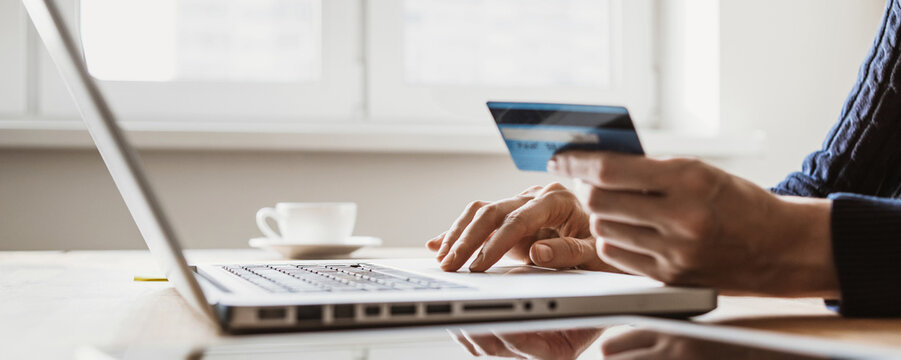 Ordering online. Woman using laptop computer with credit card,  banner. Business, online shopping, e-commerce, internet banking, spending money, working from home concept