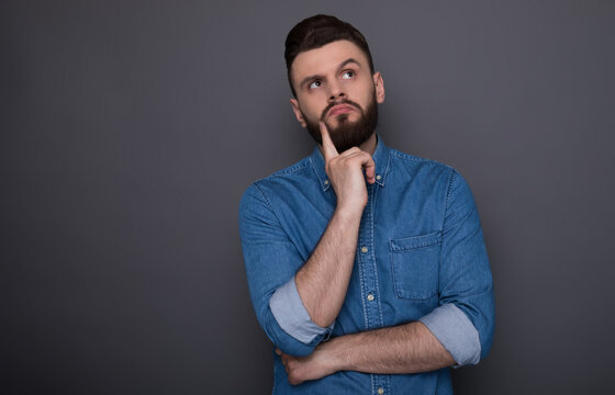 Beautiful modern smart confident man has some ideas while thinking process