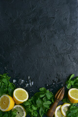 Food background with ingredients for making lemonade or citrus cocktail. Top view with copy space.