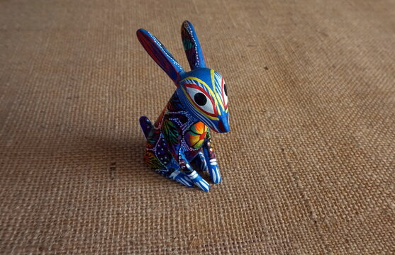 Blue Multi Color Mexican Painted Bunny on Tan Burlap