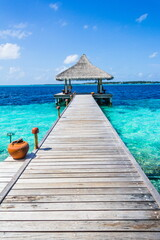 Wooden pier on a tropical beach in the Maldives